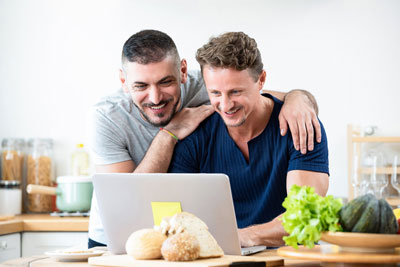 Happy-Gay-Male-Couple-Browsing